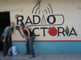 Volunteers at Radio Victoria in El Salvador interact with the mural mike.
